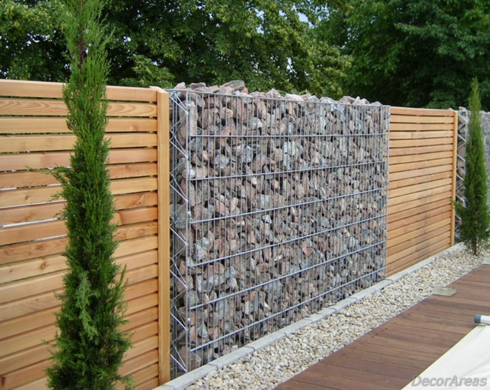 Stone and wood garden fence