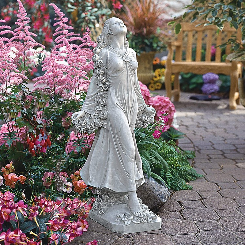Woman statue decorated with flowers