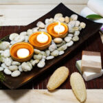 Pebble Stone And Candles